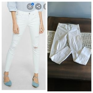 Express distressed mid rise white jeggings